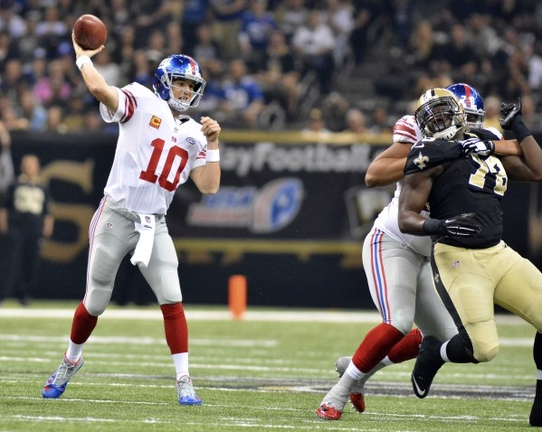 Nov 1, 2015; New Orleans, LA, USA; New York Giants quarterback Eli Manning (10) makes a pass during the first quarter of the game against the New Orleans Saints at the Mercedes-Benz Superdome. Man ...
