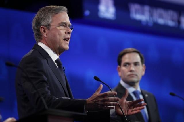 Republican U.S. presidential candidate former Governor Jeb Bush speaks as U.S. Senator Marco Rubio (R) looks on at the 2016 U.S. Republican presidential candidates debate held by CNBC in Boulder,  ...