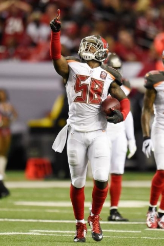 Nov 1, 2015; Atlanta, GA, USA; Tampa Bay Buccaneers middle linebacker Kwon Alexander (58) celebrates after an interception against the Atlanta Falcons during the first half at the Georgia Dome. (D ...