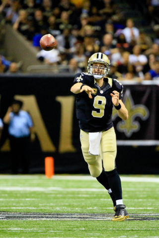 Nov 1, 2015; New Orleans, LA, USA; New Orleans Saints quarterback Drew Brees (9) throws against the New York Giants during the second half of a game at the Mercedes-Benz Superdome. The Saints defe ...