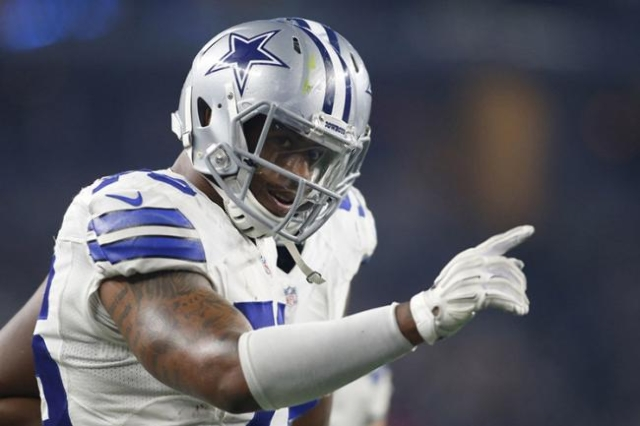 Nov 1, 2015; Arlington, TX, USA; Dallas Cowboys defensive end Greg Hardy (76) reacts after intercepting a pass by Seattle Seahawks quarterback Russell Wilson (not pictured) in the third quarter at ...
