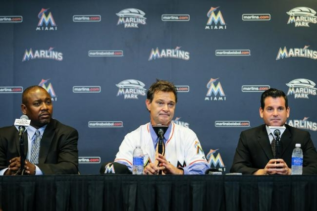Nov 2, 2015; Miami, FL, USA; Miami Marlins manager Don Mattingly (center) answers questions from reporters next to president baseball operations Michael Hill (left) and president David Samson (rig ...