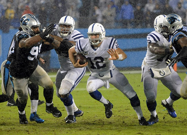 Nov 2, 2015; Charlotte, NC, USA; Indianapolis Colts quarterback Andrew Luck (12) runs the ball during the first half of the game against the Carolina Panthers at Bank of America Stadium. Mandatory ...