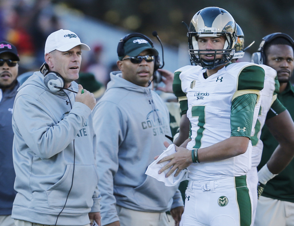 Nov 7, 2015; Laramie, WY, USA; Colorado State Rams head coach Mike Bobo (L) talks to quarterback Nick Stevens (7) on the sidelines against the Wyoming Cowboys during the third quarter at War Memor ...