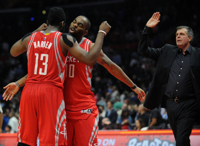 November 7, 2015; Los Angeles, CA, USA; Houston Rockets guard James Harden (13), guard Marcus Thornton (10) and head coach Kevin McHale celebrate the 109-101 victory against Los Angeles Clippers a ...