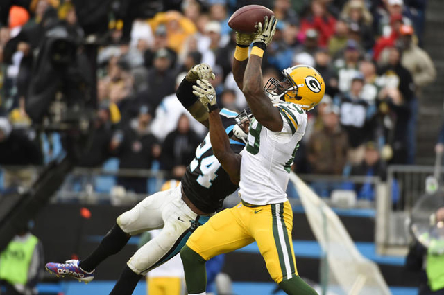 Nov 8, 2015; Charlotte, NC, USA; Green Bay Packers wide receiver James Jones (89) catches the ballon fourth down as Carolina Panthers cornerback Josh Norman (24) defends in the fourth quarter. The ...