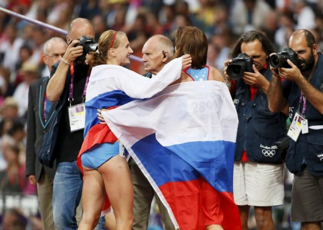 Russia's Mariya Savinova, right, is congratulated by compatriot and third-placed Ekaterina Poistogova after she won the women's 800m final during the London 2012 Olympic Games at the O ...