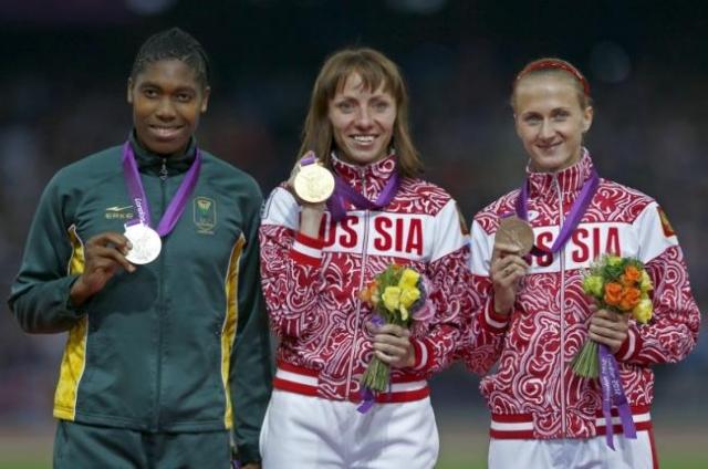 Russia's Mariya Savinova, center, wins gold, South Africa's Caster Semenya, left, won silver and Russia's Ekaterina Poistogova won bronze during the women's 800m victory ce ...
