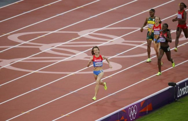 Russia's Mariya Savinova smiles as she wins gold in the women's 800m final at the London 2012 Olympic Games at the Olympic Stadium, Aug. 11, 2012. (Max Rossi/Reuters/Files)