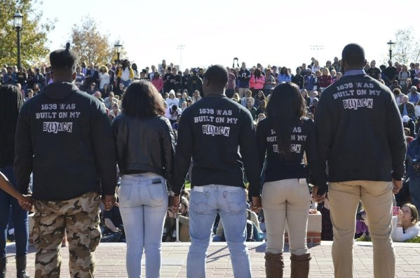 Members of Concerned Student 1950 join hands at a press conference at Traditions Plaza at Carnahan Quad, on the University of Missouri campus in Columbia, Missouri, November 9, 2015. University of ...