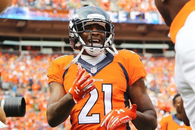 Sep 13, 2015; Denver, CO, USA; Denver Broncos cornerback Aqib Talib (21) celebrates after scoring a touchdown after intercepting a pass during the second half against the Baltimore Ravens at Sport ...