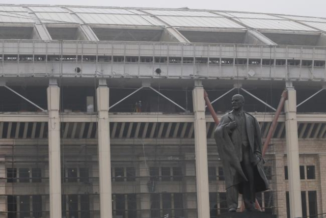 A monument of the Soviet state founder Vladimir Lenin is seen in front of the Luzhniki stadium, which hosted the IAAF World Athletics Championships 2013 and is now under reconstruction, in Moscow, ...