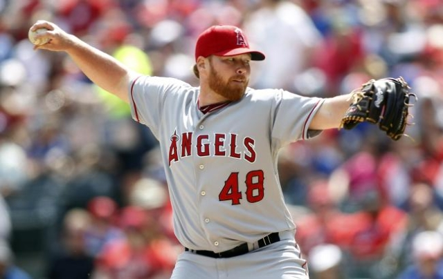 Los Angeles Angels starting pitcher Tommy Hanson pitches against the Texas Rangers in the first inning of their MLB American League baseball game in Arlington, Texas in this April 6, 2013 file pho ...