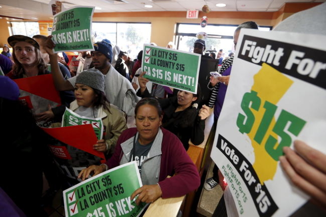 Fast-food workers and their supporters join a nationwide protest for higher wages and union rights inside McDonald's in Los Angeles, California, United States, November 10, 2015. (Lucy Nicho ...