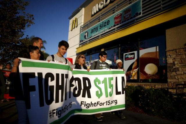 Fast-food workers and their supporters join a nationwide protest for higher wages and union rights outside McDonald's in Los Angeles, California, United States, November 10, 2015. (Lucy Nich ...