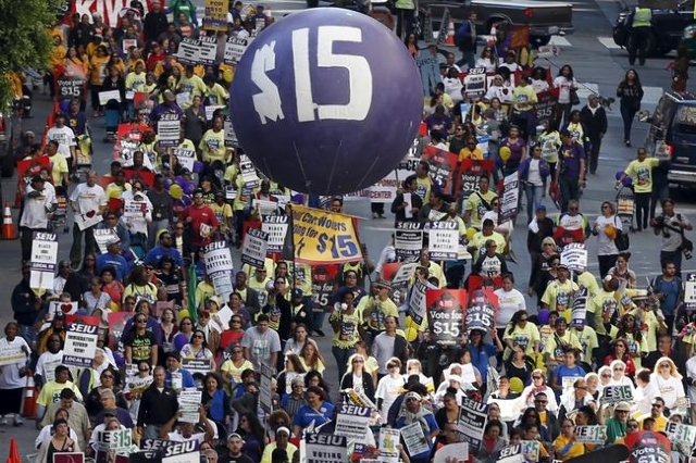 Fast-food workers and their supporters join a nationwide protest for higher wages and union rights in Los Angeles, California, United States, November 10, 2015. REUTERS/Lucy Nicholson