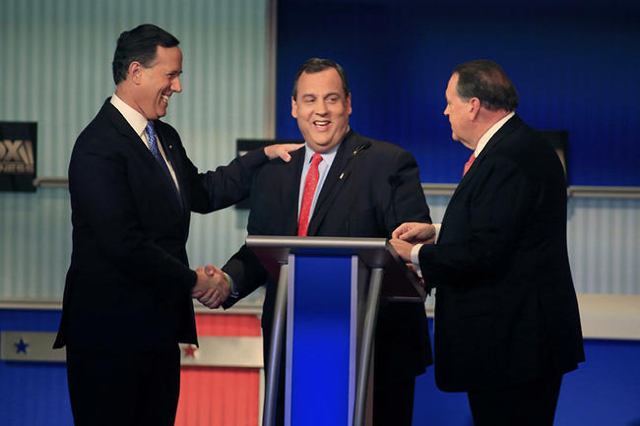 Republican U.S. presidential candidates (L-R) former U.S. Senator Rick Santorum, New Jersey Governor Chris Christie and former Arkansas Governor Mike Huckabee shake hands at the conclusion of a fo ...