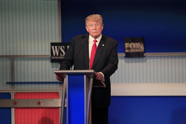 Republican U.S. presidential candidate businessman Donald Trump listens to the moderator at the debate held by Fox Business Network for the top 2016 U.S. Republican presidential candidates in Milw ...