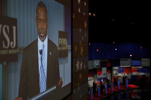 Republican U.S. presidential candidate Dr. Ben Carson is seen on a video monitor as the candidates participate in the debate held by Fox Business Network for the top 2016 U.S. Republican president ...