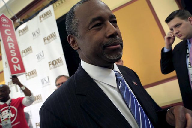 Republican Presidential candidates Ben Carson takes questions from the media in the spin room after the debate held by Fox Business Network for the top 2016 U.S. Republican candidates in Milwaukee ...
