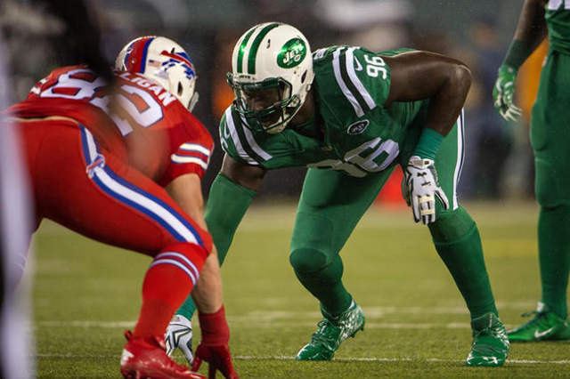 Nov 12, 2015; East Rutherford, NJ, USA;  New York Jets defensive end Muhammad Wilkerson (96) lines up against Buffalo Bills tight end Matthew Mulligan (82) in the 1st quarter at MetLife Stadium. M ...