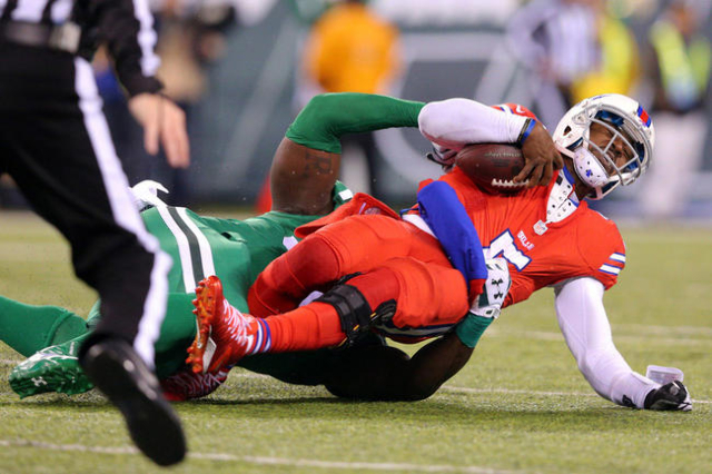 Nov 12, 2015; East Rutherford, NJ, USA; Buffalo Bills quarterback Tyrod Taylor (5) is sacked by New York Jets defensive end Muhammad Wilkerson (96) during the second quarter at MetLife Stadium. Ma ...