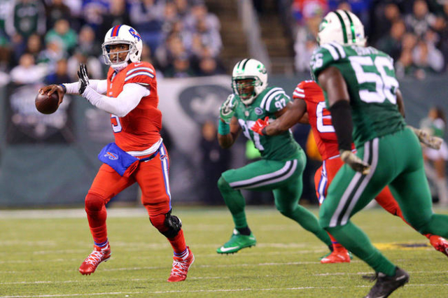 Nov 12, 2015; East Rutherford, NJ, USA; Buffalo Bills quarterback Tyrod Taylor (5) passes the ball against the New York Jets during the second quarter at MetLife Stadium. Mandatory Credit: Brad Pe ...