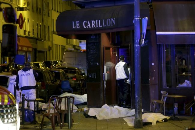 A general view of the scene that shows the covered bodies outside a restaurant following a shooting incident in Paris,  Nov. 13, 2015. (Philippe Wojazer/Reuters)