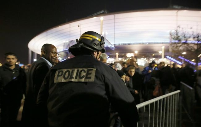Police control crowds leaving the Stade de France where explosions were reported to have detonated outside the stadium during the France vs German friendly match near Paris, Nov. 13, 2015.  (Gonaz ...