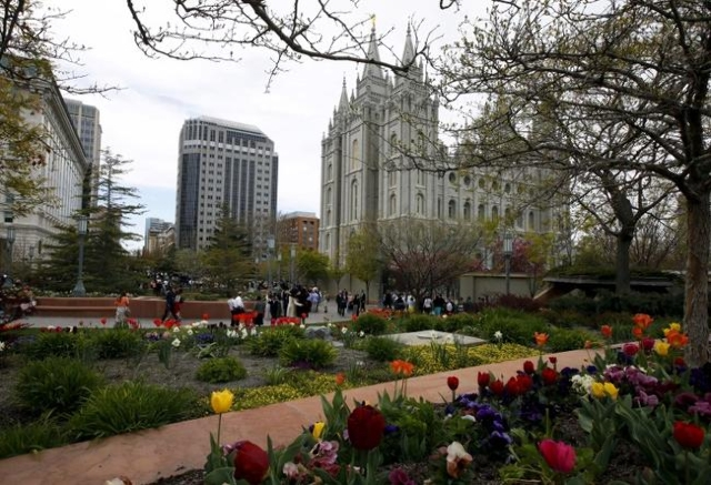 People gather around the historic Mormon Salt Lake Temple between sessions at The Church of Jesus Christ of Latter-day Saints' 185th Annual General Conference in Salt Lake City on April 4, 2 ...