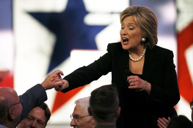 Democratic U.S. presidential candidate and former Secretary of State Hillary Clinton shakes hands with attendees after the conclusion of the second official 2016 U.S. Democratic presidential candi ...