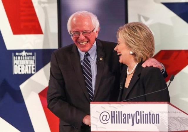 Nov 14, 2015; Des Moines, IA, USA; Bernie Sanders (left) greets Hillary Clinton after the Democratic presidential debate at Drake University. Mandatory Credit: Rodney White/The Des Moines Register ...