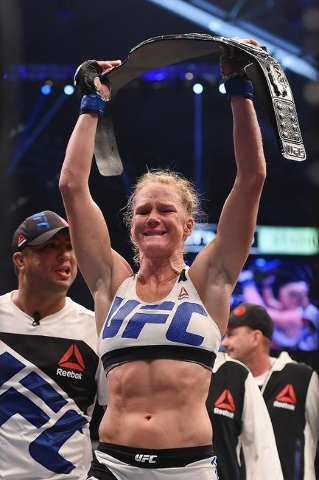 Nov 15, 2015; Melbourne, Australia; Holly Holm (blue gloves) celebrates after defeating Ronda Rousey (not pictured) during UFC 193 at Etihad Stadium. (Reuters/Matt Roberts-USA TODAY Sports)
