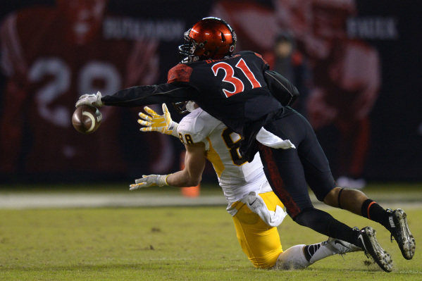 Nov 14, 2015; San Diego, CA, USA; San Diego State Aztecs defensive back Derek Babiash (31) bats down a pass intended for Wyoming Cowboys tight end Jacob Hollister (88) during the fourth quarter at ...