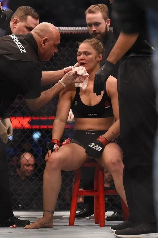 Nov 15, 2015; Melbourne, Australia; Ronda Rousey (red gloves) receives attention after being defeated by Holly Holm (not pictured) during UFC 193 at Etihad Stadium. (Reuters/Matt Roberts-USA TODAY ...