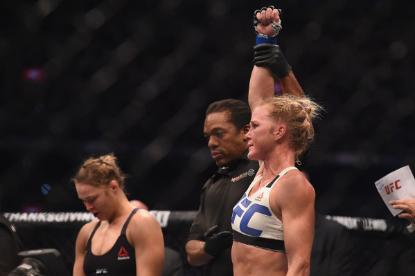 Nov 15, 2015; Melbourne, Australia; Holly Holm (blue gloves) celebrates after defeating Ronda Rousey (not pictured) during UFC 193 at Etihad Stadium. Mandatory Credit: Matt Roberts-USA TODAY Sports