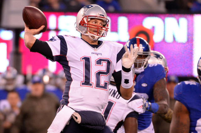 Nov 15, 2015; East Rutherford, NJ, USA; New England Patriots quarterback Tom Brady (12) throws a pass against the New York Giants in the first half during the game at MetLife Stadium. (Robert Deut ...