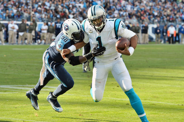 Carolina Panthers quarterback Cam Newton (1) rushes toward the goal line against Tennessee Titans outside linebacker Brian Orakpo (98) during the second half at Nissan Stadium. (Jim Brown-USA TODA ...