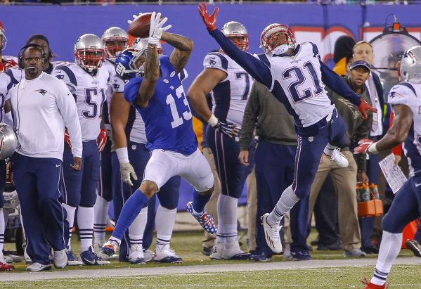 Nov 15, 2015; East Rutherford, NJ, USA;  Patriots cornerback Malcolm Butler (21) is unable to prevent New York Giants wide receiver Odell Beckham (13) from catching a pass in the fourth quarter at ...