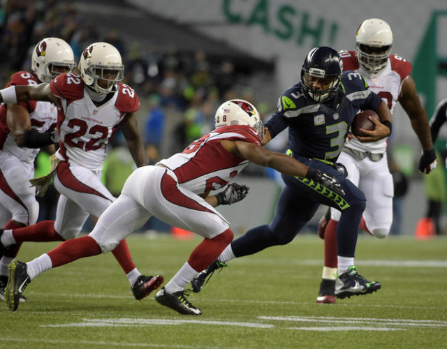 Seattle Seahawks quarterback Russell Wilson (3) is pressured by Arizona Cardinals strong safety Tony Jefferson (22), cornerback Justin Bethel (28) and defensive end Cory Redding (90))during a NFL  ...