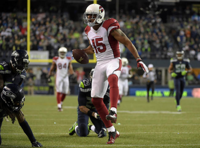 Arizona Cardinals wide receivers Michael Floyd (15) celebrates during a NFL football game against the Seattle Seahawks at CenturyLink Field. Mandatory Credit: Kirby Lee-USA TODAY Sports