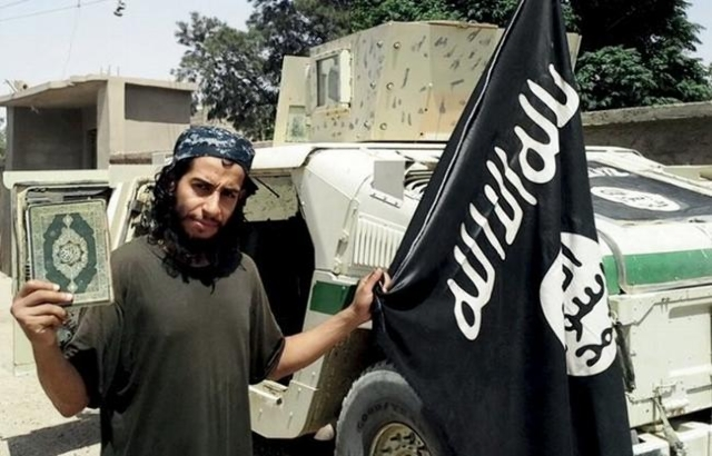 An undated photograph of a man described as Abdelhamid Abaaoud that was published in the Islamic State's online magazine Dabiq and posted on a social media website. (Social Media Website via ...