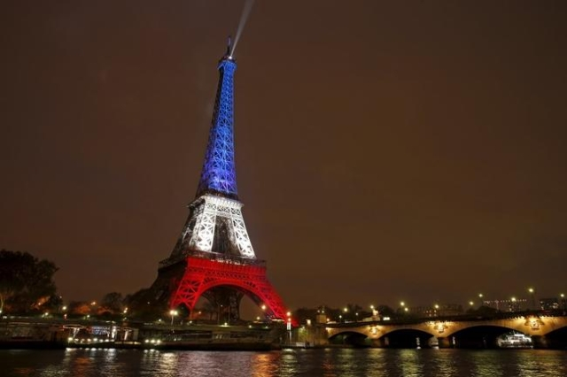 The Eiffel Tower is lit with the blue, white and red colors of the French flag in Paris, Nov. 16, 2015. (Benoit Tessier/Reuters/Files)