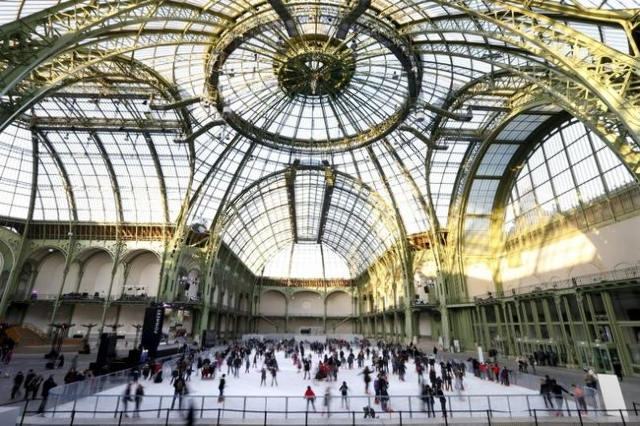Skaters enjoy the ice on a giant ice rink at the Grand Palais exhibition hall in Paris, Dec. 12, 2012. (Charles Platiau/Reuters/Files)