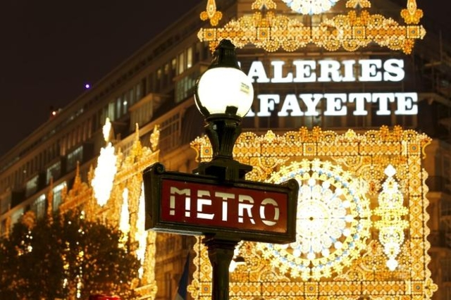 View of a metro sign in front the Galeries Lafayette department store with Christmas lights in Paris, Nov. 8, 2011. (Charles Platiau/Reuters/Files)