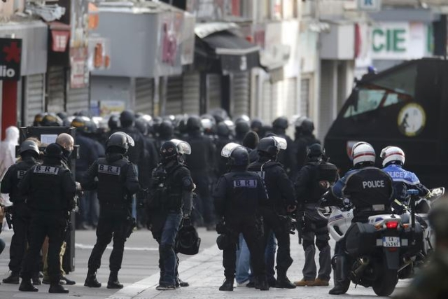 Members of French special police forces of the Research and Intervention Brigade (BRI) are seen near a raid zone in Saint-Denis, near Paris, France, November 18, 2015 during an operation to catch  ...