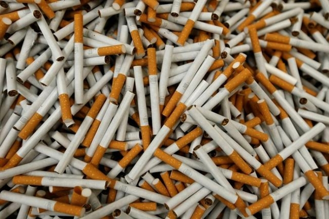 Cigarettes are seen during the manufacturing process in the British American Tobacco Cigarette Factory (BAT) in Bayreuth, southern Germany, April 30, 2014. (Reuters/Michaela Rehle)