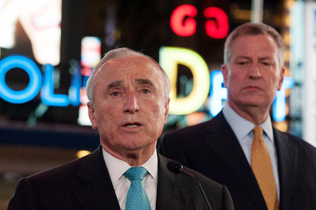 New York City Police Commissioner William Bratton (C) and New York City Mayor Bill de Blasio (R) deliver remarks at a news conference in Times Square in the Manhattan borough in New York, November ...