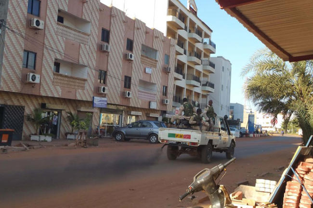 Security forces drive near the Radisson hotel in Bamako, Mali, November 20, 2015. Gunmen shouting Islamic slogans attacked a luxury hotel full of foreigners in Mali's capital Bamako early on ...
