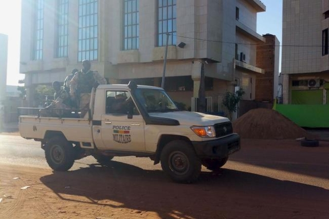 Security forces drive near the Radisson hotel in Bamako, Mali, November 20, 2015. (Adama Diarra/Reuters)